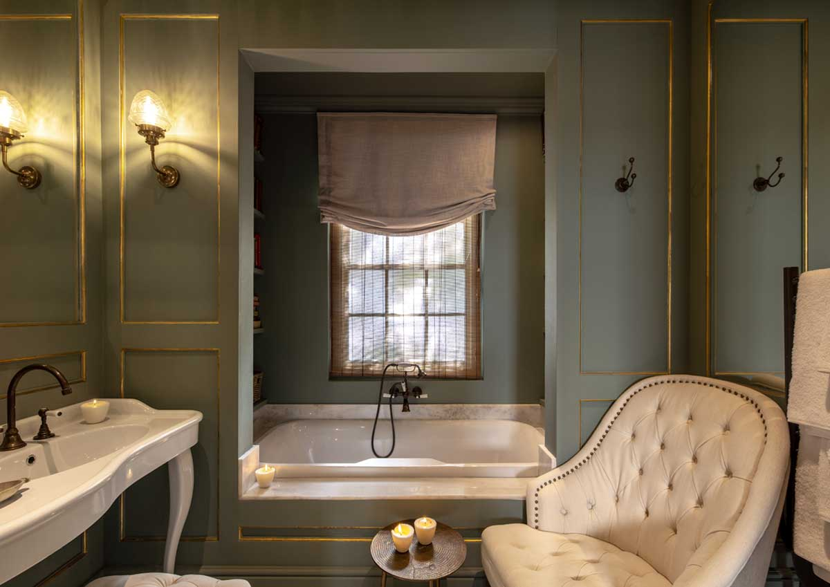 britannia bath mixer in aged brass finish with the double console basin on legs with Britannia 3 tap hole basin mixer with levers at Akademie Street boutique hotel