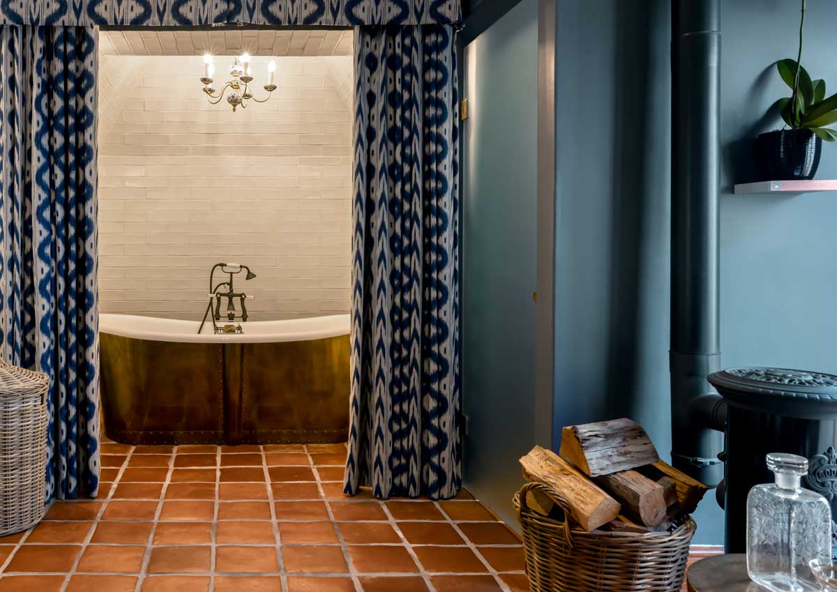 Bateau Bath in an Aged Brass skirt with Britannia bath mixer with levers in an aged brass finish