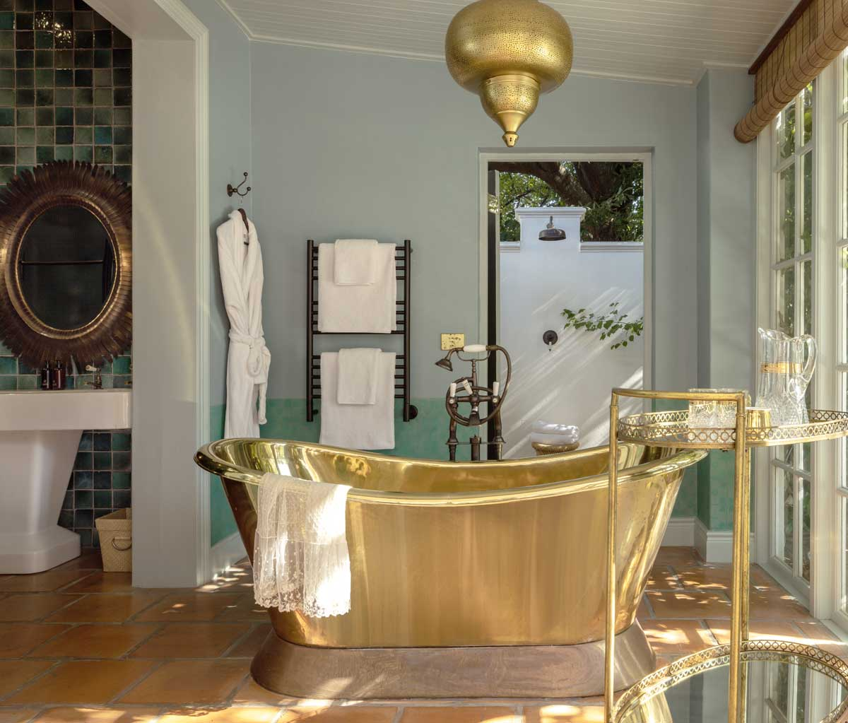 Britannia bath mixer with levers in an aged brass finish at Akademie Street Boutique Hotel by Victorian Bathrooms